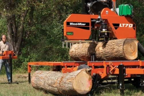 Sawing Logs for Cabins In Michigan